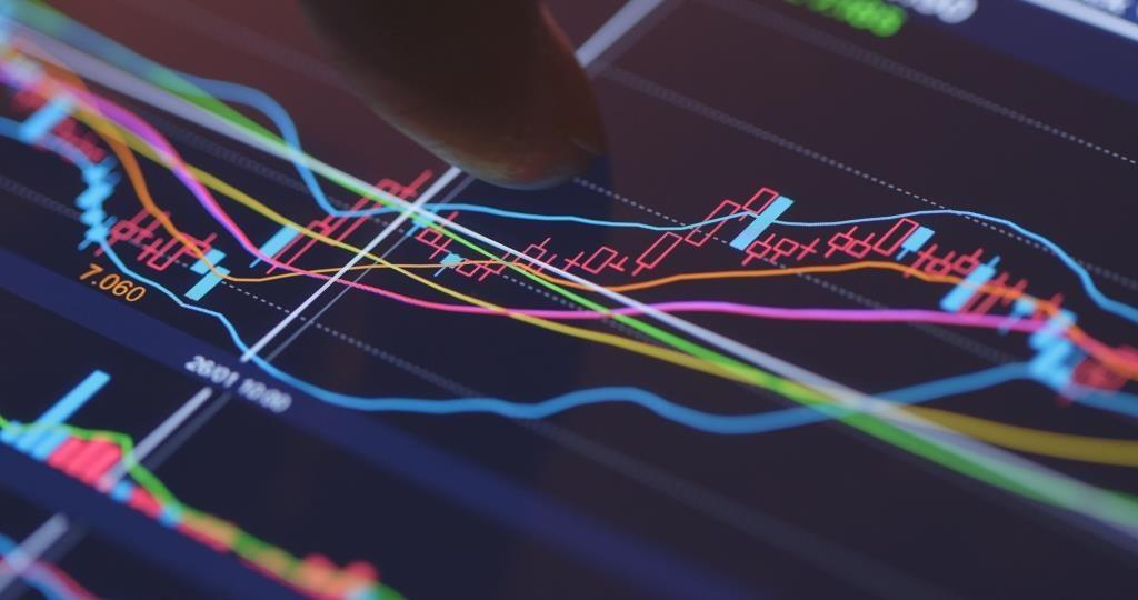 Analysis stock market data on digital screen